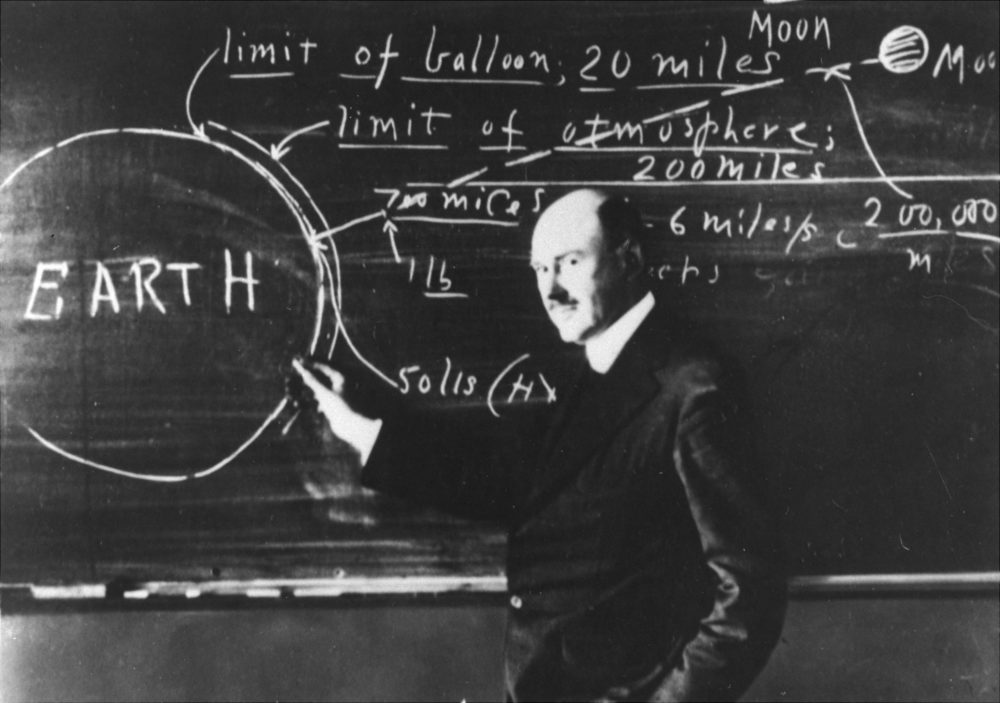 Dr. Robert H. Goddard at the blackboard at Clark University, Worcester, Mass., in 1924, explaining the method by which a rocket might reach the moon. (AP photo)