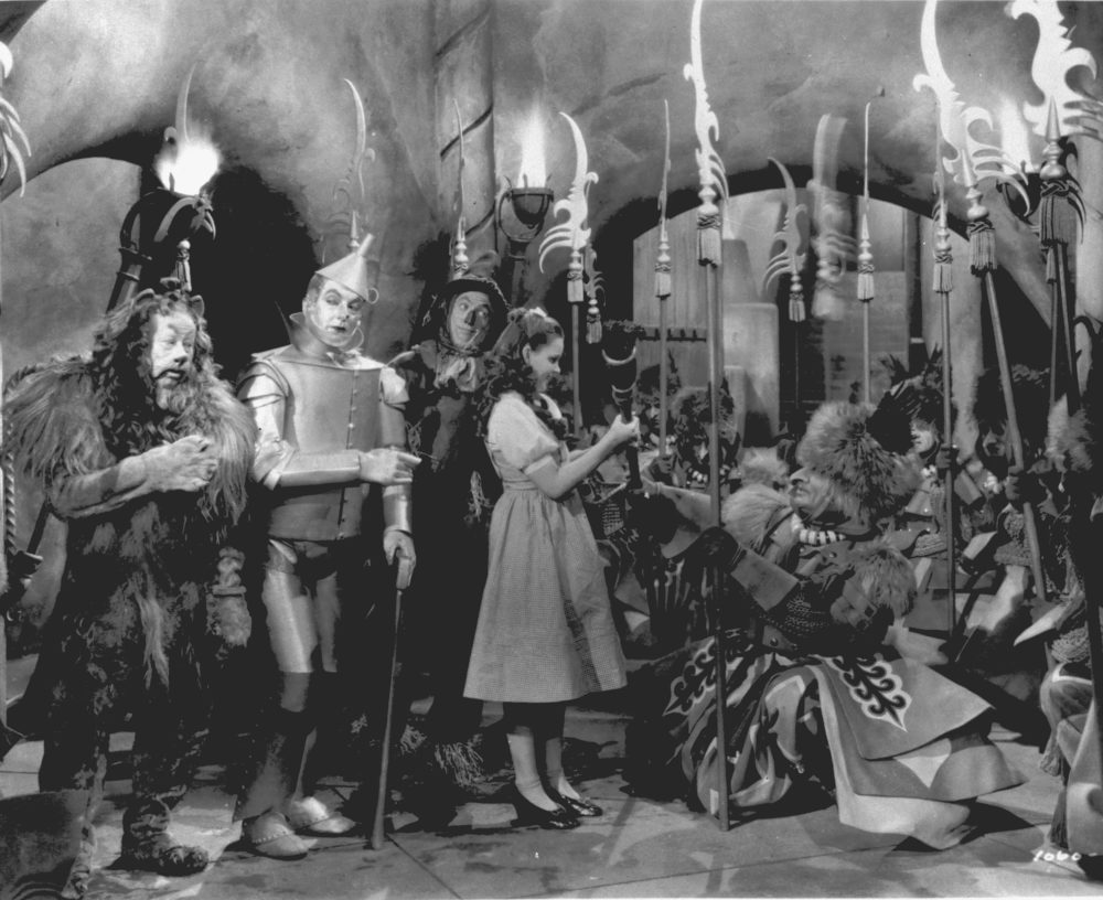 "Judy Garland, as Dorothy in ""The Wizard of Oz,"" is presented with the Witch's broom in a scene from the 1939 movie.  Garland is accompanied by, from left to right, Bert Lahr as the Cowardly Lion, Jack Haley as the Tin Man, and Ray Bolger as the Scarecrow.  (AP Photo)"
