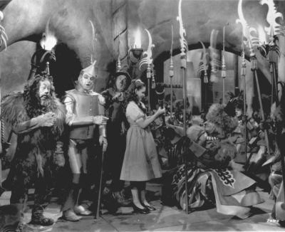 """Judy Garland, as Dorothy in """"The Wizard of Oz,"""" is presented with the Witch's broom in a scene from the 1939 movie.  Garland is accompanied by, from left to right, Bert Lahr as the Cowardly Lion, Jack Haley as the Tin Man, and Ray Bolger as the Scarecrow.  (AP Photo)"""