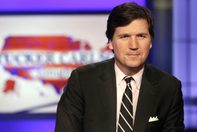 Tucker Carlson poses for photos in a Fox News Channel studio, in New York, Thursday, March 2, 2107. (Richard Drew/AP)