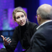 Elizabeth Holmes, founder and CEO of Theranos, left, speaks with Fortune Editor Alan Murray at the Fortune Global Forum in San Francisco, Monday, Nov. 2, 2015. (Jeff Chiu/AP)