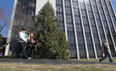 Students walk on the University of Rhode Island campus. (Stew Milne/AP)