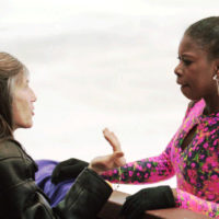 Surya Bonaly of France, right, receives instructions from her mother and coach Suzanne Bonaly, left, during a practice session in Sofia, Thursday, Jan. 25, 1996, prior to the ladies' competition to start on Friday at the European Figure Skating Championships. (Thomas Kienzle/AP)