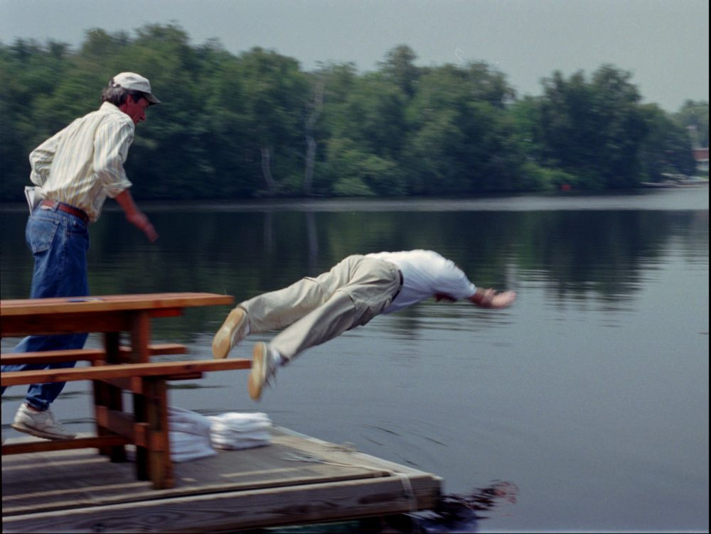 Massachusetts Gov. William Weld takes an unannounced dive into the Charles River on Wednesday, Aug. 7, 1996. (Gail Oskin/AP)