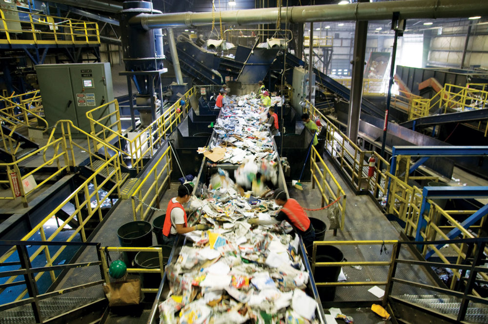 Workers sort materials at Casella's facility in Auburn. (Courtesy of Casella)