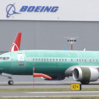 A Boeing 737 MAX 8 being built for Oman Air taxis past a Boeing hanger after landing at Boeing Field, Friday, March 22, 2019, in Seattle. In a blow for Boeing, Indonesia's flag carrier is seeking the cancellation of a multibillion dollar order for 49 of the manufacturer's 737 Max 8 jets, citing a loss of confidence after two crashes within five months. (Ted S. Warren/AP)