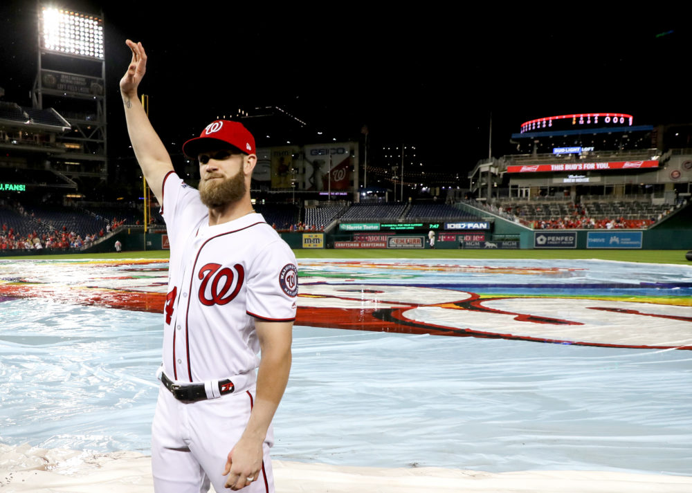 Bryce Harper waves to the crowd following the last Nationals home game of the 2018 season. Harper signed with the Philadelphia Phillies this week. (Rob Carr/Getty Images)