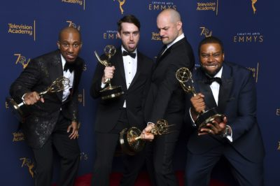 "Chris Redd, from left, Will Stephen, Eli Brueggemann, and Kenan Thompson winners of the award for outstanding original music and lyrics for ""Saturday Night Live - Host: Chance the Rapper"" pose for a portraits during night two of the Television Academy's 2018 Creative Arts Emmy Awards at the Microsoft Theater on Sunday, Sept. 9, 2018, in Los Angeles. (Photo by Vince Bucci/Invision/AP)"