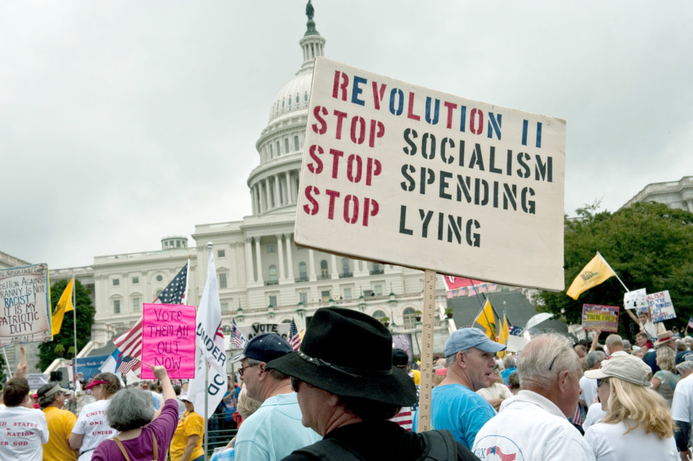 A demonstrator carries a sign calling for a second American revolution to bring an end to alleged socialism during a march by supporters of the conservative Tea Party movement in Washington, D.C., on September 12, 2010. (Nicholas Kamm/AFP/Getty Images)