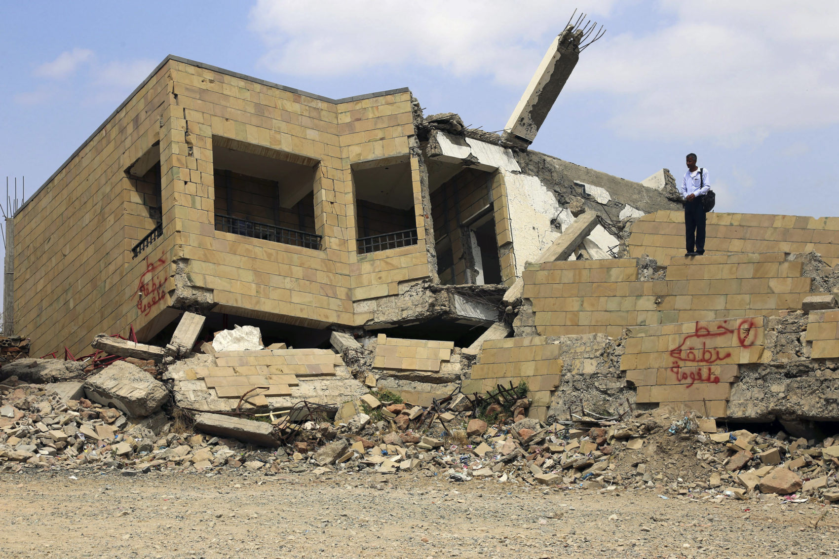 A Yemeni student stands on top of the debris of a school, that was damaged last year following a Saudi-led coalition air strike against Shiite Huthi, in the country's third-city of Taez, on March 6, 2019. (-/AFP/Getty Images)