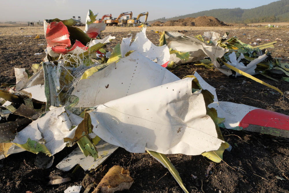 Debris lays piled up just outside the impact crater after being gathered by workers during the continuing recovery efforts at the crash site of the Ethiopian Airlines flight on March 11, 2019 in Bishoftu, Ethiopia.  (Jemal Countess/Getty Images)