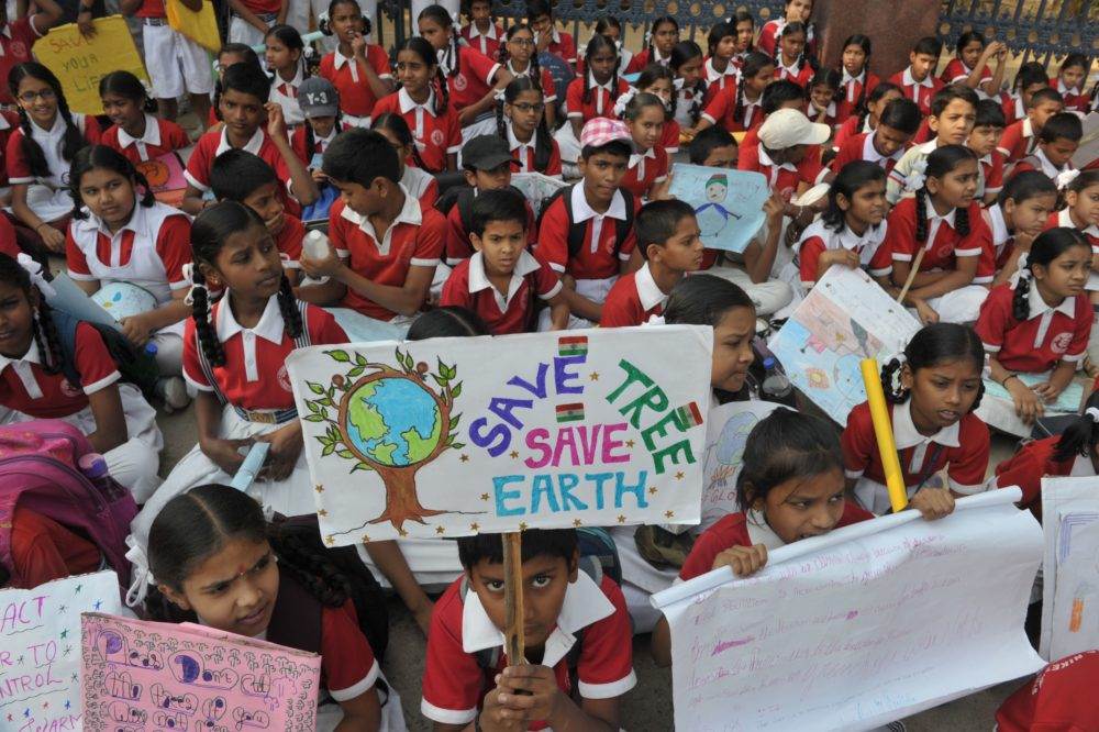 Indian school students hold placards as they take part in a protest against global warming in Hyderabad on March 15, 2019. (Noah Seelam/AFP/Getty Images)