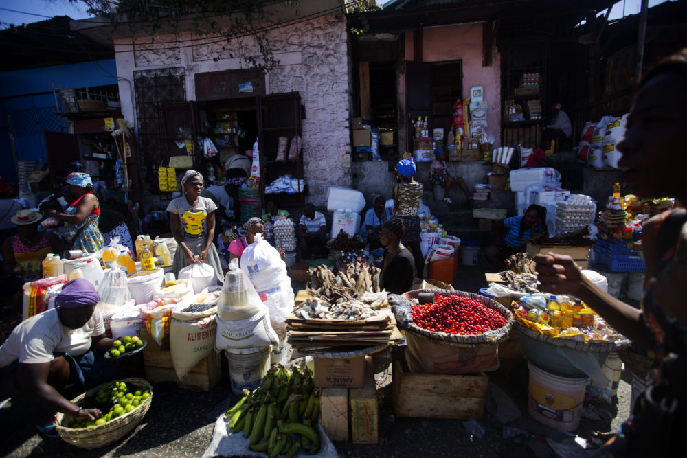 Vendors wait for clients at an open-air market in Port-au-Prince, Haiti, on Feb. 18, 2019, when businesses and government offices slowly reopened across Haiti after more than a week of demonstrations. (Dieu Nalio Chery/AP)