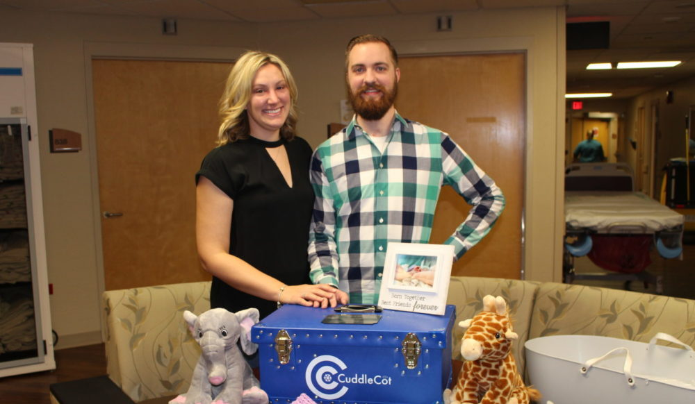 Chris and Emily Fricker with their CuddleCot. (Courtesy of Emily Fricker)