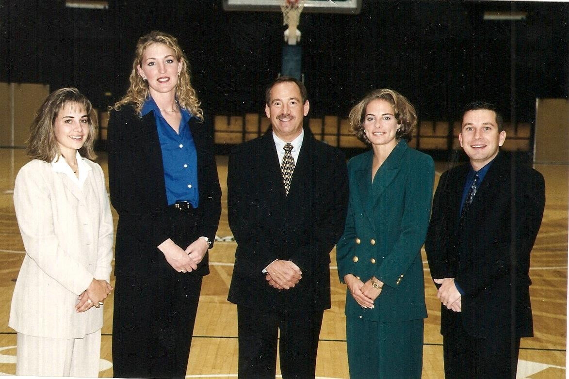 Tom (center) and Nicki (second from right) with the Colorado State women's basketball coaching staff in 1999. (Courtesy Nicki Collen)