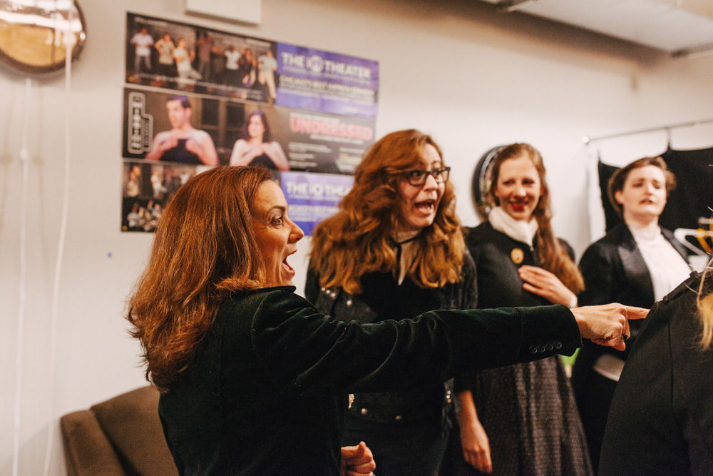 The cast of Improvised Jane Austen warms up in the green room before their performance at the iO theater in Chicago, IL, Feb. 26, 2019. (Danielle Scruggs for Here & Now)
