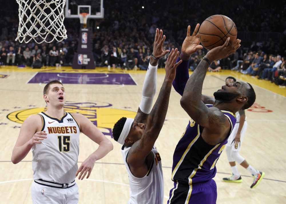 Los Angeles Lakers forward LeBron James scores during Wednesday's game in Los Angeles. With that basket, James moved past Michael Jordan for fourth place on the NBA career scoring list. (Mark J. Terrill/AP)