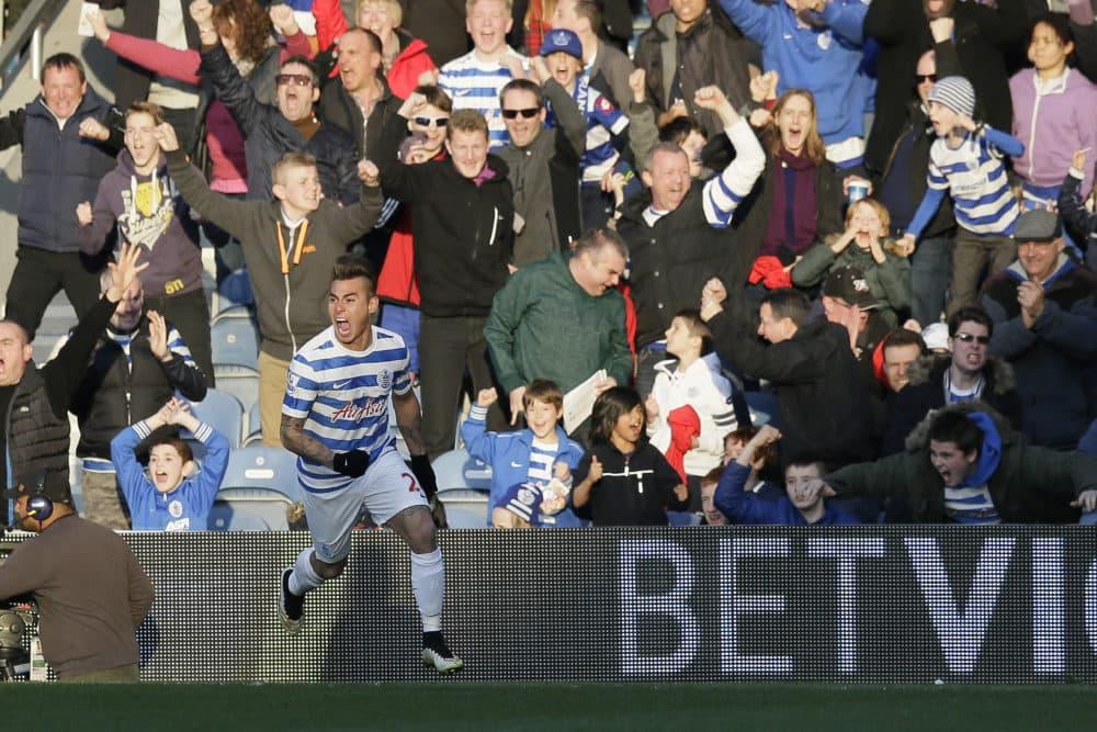 Queens Park Rangers fans celebrate a goal at Loftus Road Stadium in London. (Tim Ireland/AP)