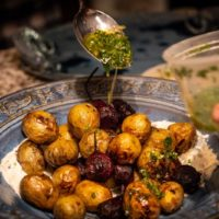 Blistered baby potatoes and beets cooked by Dope Dinners. The roasted baby Russian potatoes and baby beets are served with a medicated honey-whipped ricotta. (Courtesy)