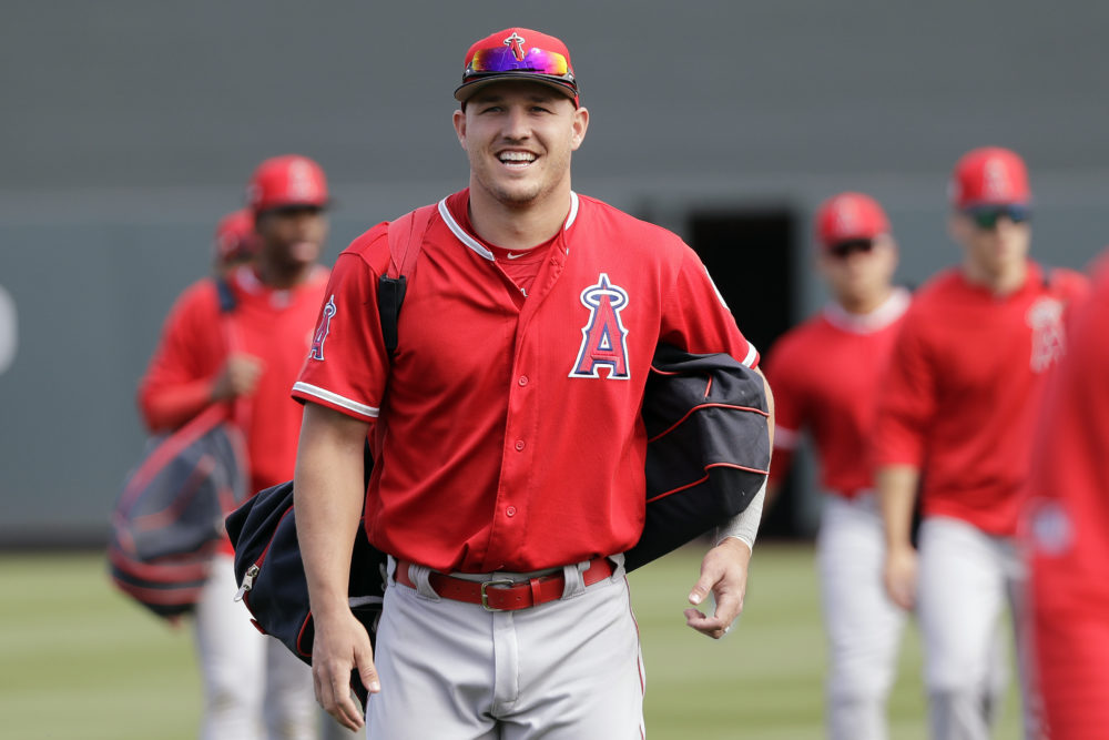 Los Angeles Angels' Mike Trout has 430 million reasons to smile as he walks onto the field before a spring training game this week. (Elaine Thompson/AP)