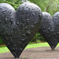 """Two Big Black Hearts"" at the deCordova Sculpture Park. (Courtesy deCordova)"
