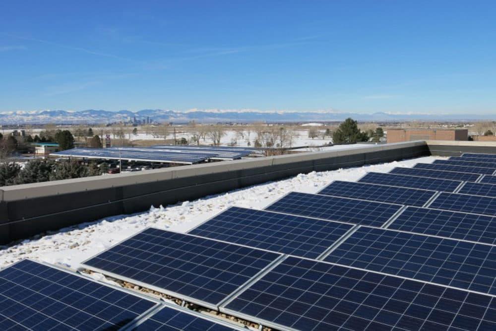 Kaiser Permanente's regional Denver office hosts solar panels on its roof and carports. (Grace Hood/Colorado Public Radio)