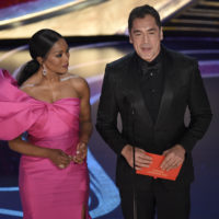 Angela Bassett, left, and Javier Bardem present the award for best foreign language film at the Oscars on Sunday, Feb. 24, 2019, at the Dolby Theatre in Los Angeles. (Photo by Chris Pizzello/Invision/AP)