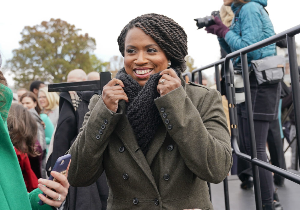 Then-Rep.-elect Ayanna Pressley, D-Mass., adjusts her coat after posing with other members of the freshman class of Congress for a group photo on Capitol Hill in Washington in November 2018. (Pablo Martinez Monsivais/AP)