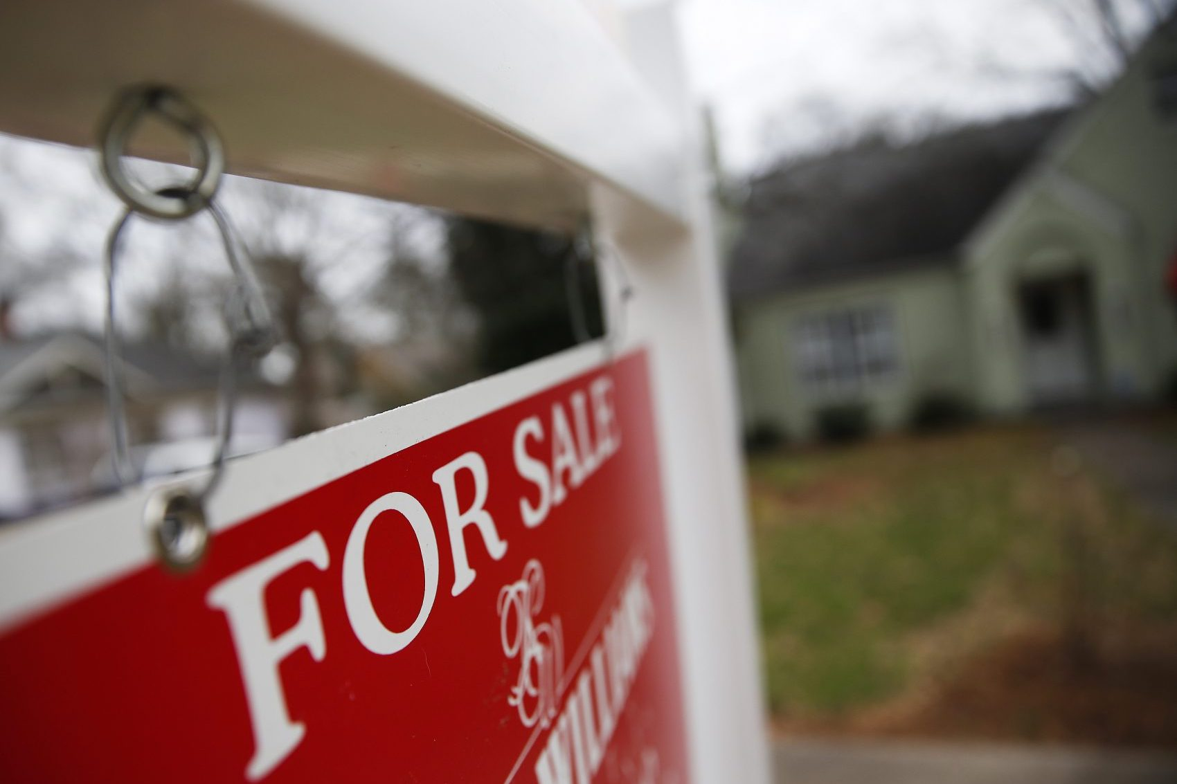 """This Jan. 26, 2016 file photo shows a """"For Sale"""" sign hanging in front of an existing home in Atlanta. (John Bazemore/AP)"""