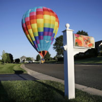 A large hot air balloon lands in the road near Newtown, Pa., Friday, Sept. 6, 2013. (Mel Evans/AP)