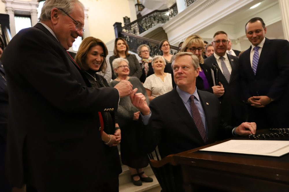 Gov. Charlie Baker held a ceremonial signing event Monday afternoon for a new law setting aside money to cover potential federal funding cuts to family planning clinics that provide abortions or abortion referrals. (Sam Doran/SHNS)