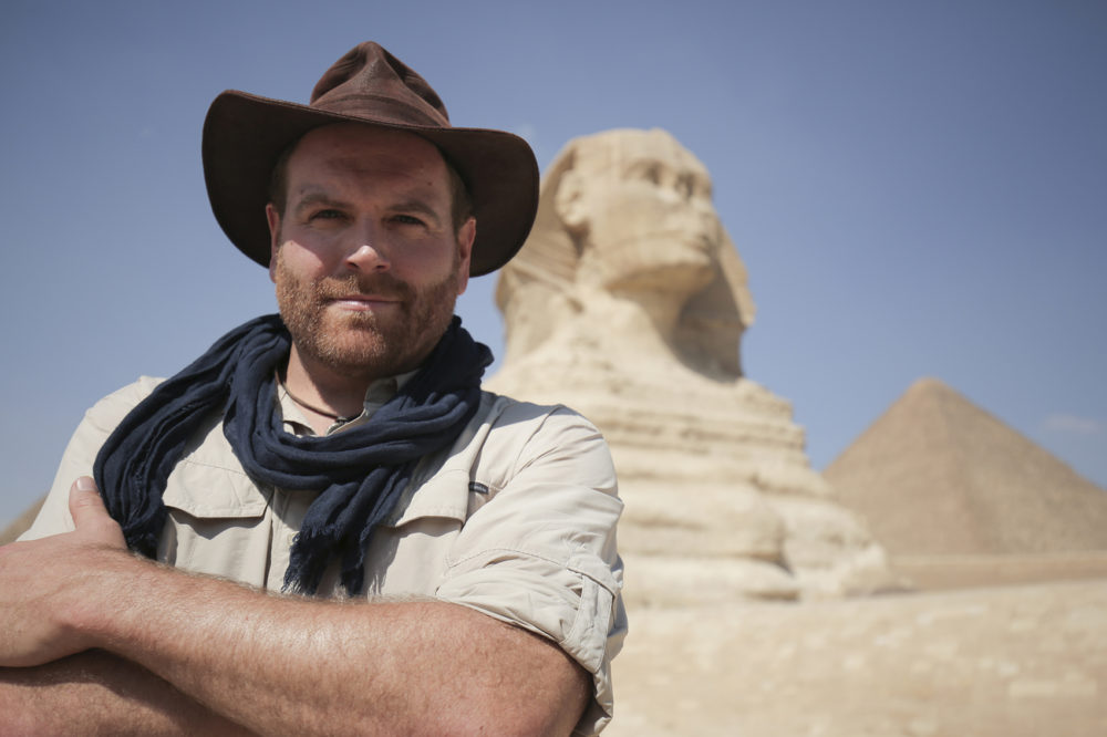 "Josh Gates, host of Discovery's ""Expedition Unknown,"" in front of the Sphinx in Giza, Egypt. (Courtesy of Discovery)"