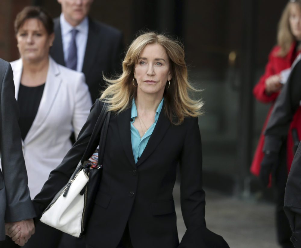 Actress Felicity Huffman departs federal court in Boston. (Charles Krupa/AP)