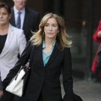 Actress Felicity Huffman departs federal court in Boston on April 3. (Charles Krupa/AP)