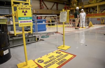 Signs warn of radiation and restrict access to working areas above the reactor at Pilgrim. (Robin Lubbock/WBUR)
