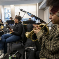 """Terri Lyne Carrington joins students on the drums as they play the Thelonius Monk song """"Bemsha Swing"""" at Berklee's Institute of Jazz and Gender Justice class. (Jesse Costa/WBUR)"""