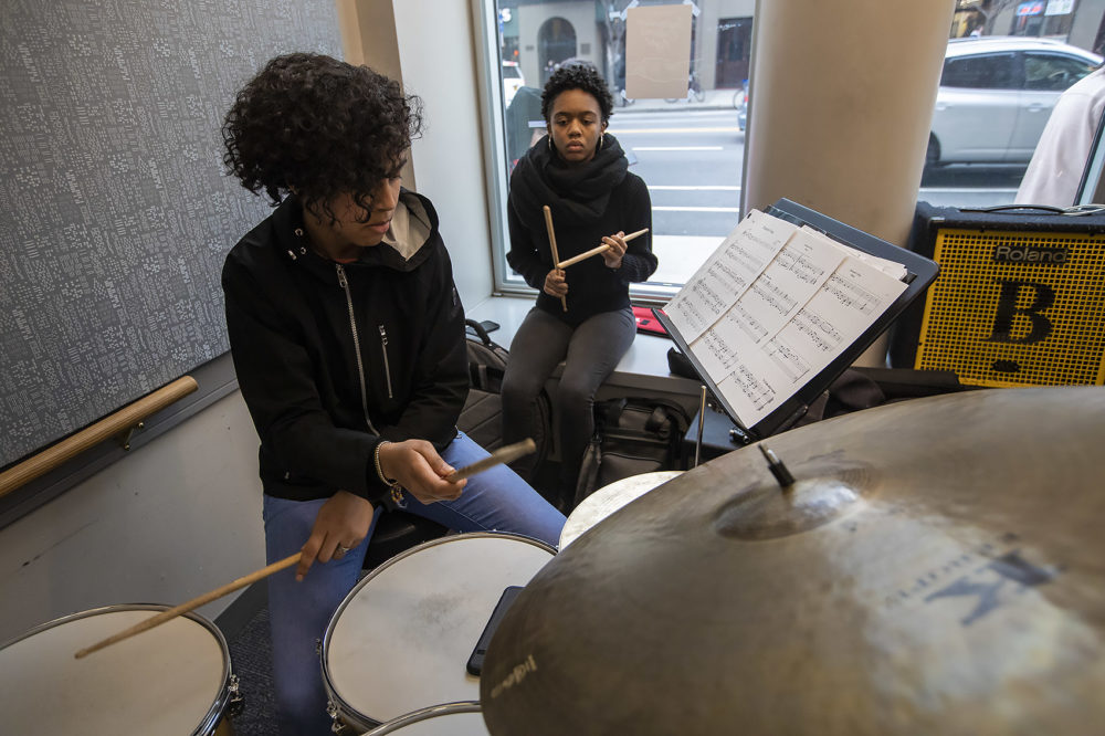 A student plays drums during a Berklee Institute of Jazz and Gender Justice class. (Jesse Costa/WBUR)