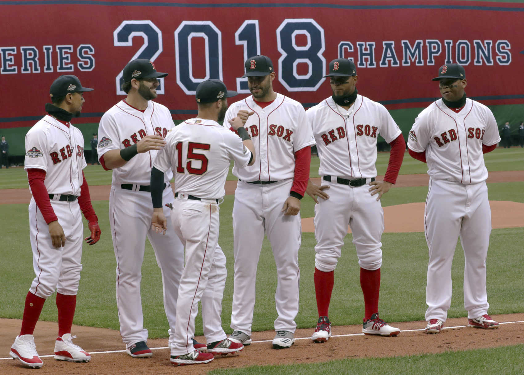 3b738af68 Boston Red Sox second baseman Dustin Pedroia (15) exchanges a fist bump  with J.D.