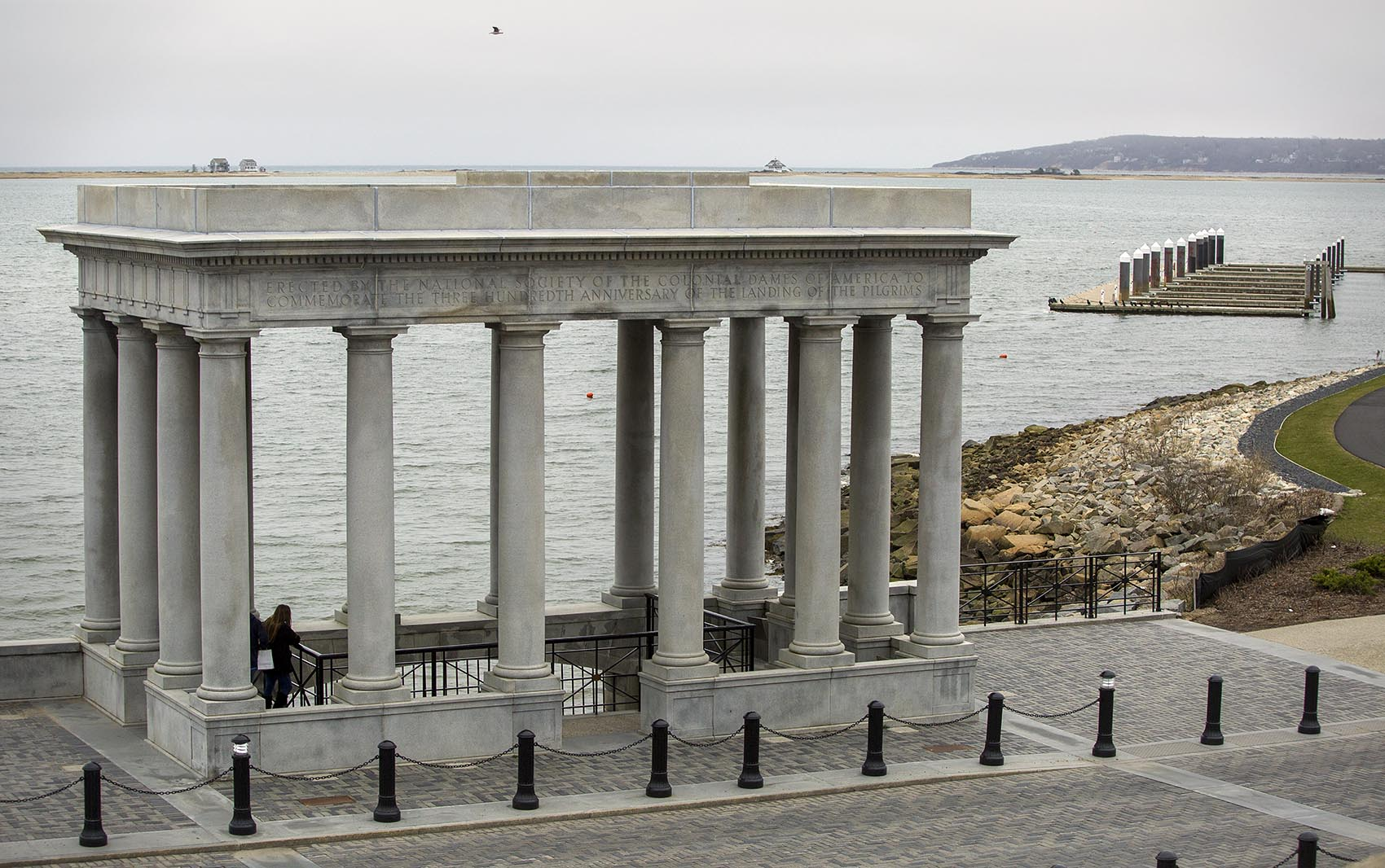 The Plymouth Rock portico looks out across the Plymouth Bay to Rocky Point, the location of Pilgrim Nuclear Power Station. (Robin Lubbock/WBUR)