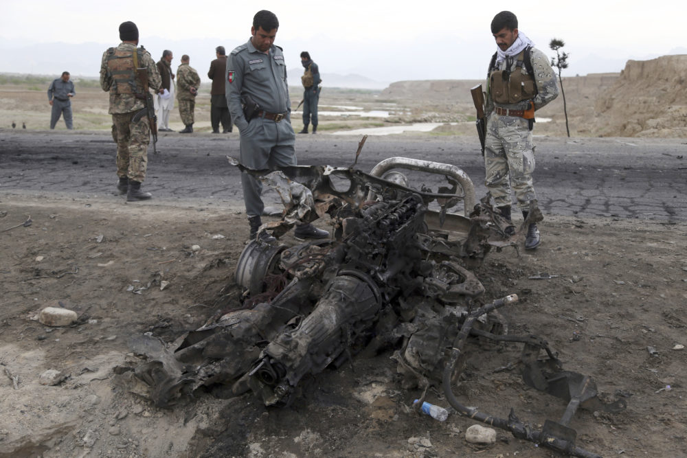 Three American service members and a U.S. contractor were killed when their convoy hit a roadside bomb on Monday near the main U.S. base in Afghanistan, the U.S. forces said. The Taliban claimed responsibility for the attack. (Rahmat Gul/AP)