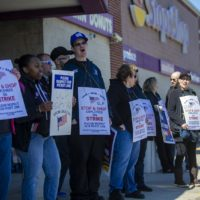 Stop & Shop workers strike outside the main entrance of the Somerville location on McGrath Highway. (Jesse Costa/WBUR)