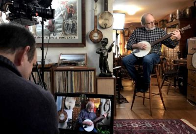 Marc Fields and his team films an interview at Jim Bollman's house in Arlington. (Andrea Shea/WBUR)