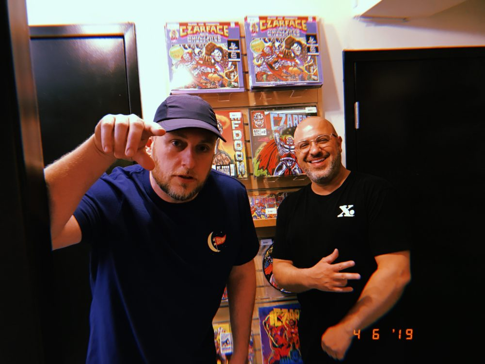 MC Esoteric and DJ 7L stand in front of Czarface records at Newbury Comics in Boston. (Brendan McGuirk for WBUR)