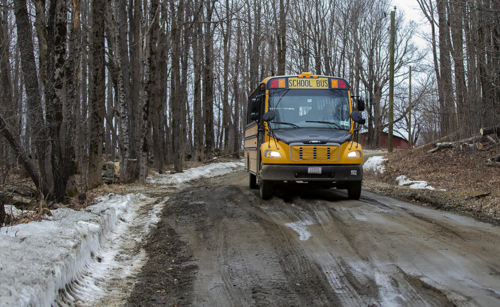 Joanne Deady's school bus navigates carefully over a icy and mud-covered Christian Hill Road in Colrain. (Jesse Costa/WBUR)