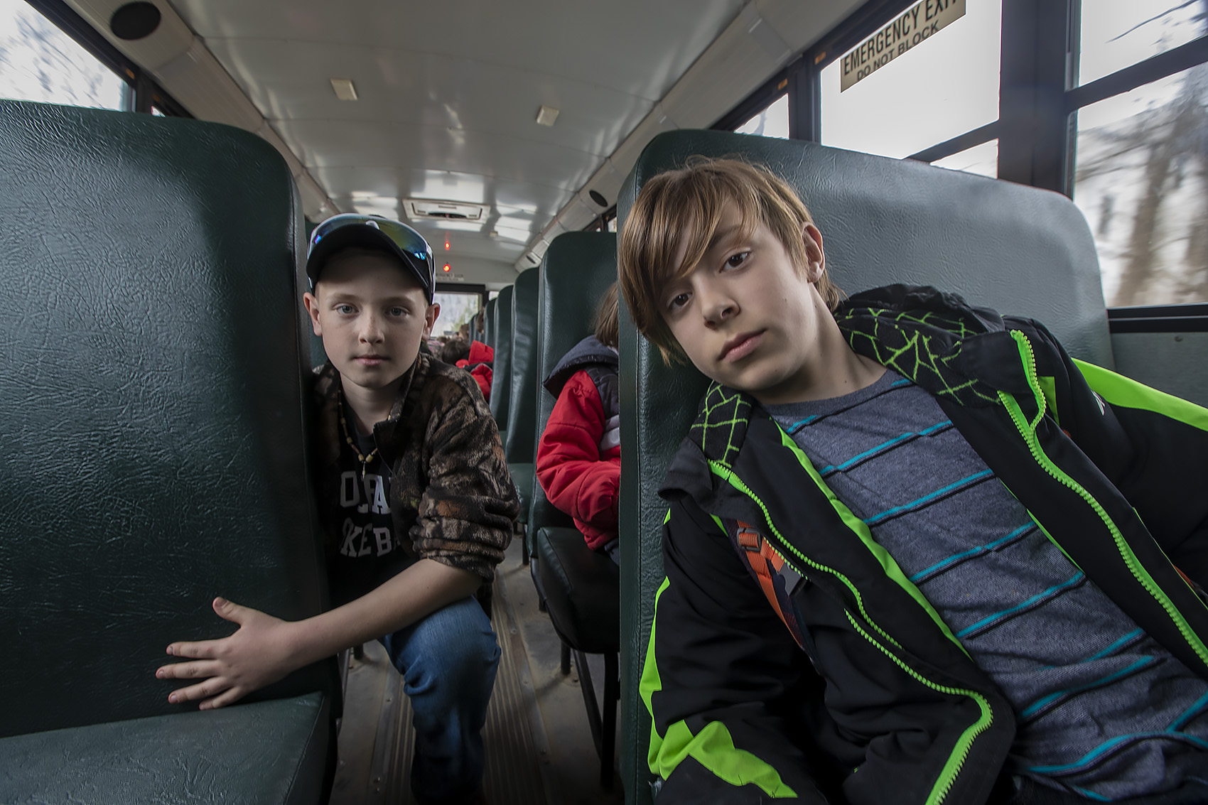Kaiden Piantanida, left, and Everett Jones on the school bus. (Jesse Costa/WBUR)