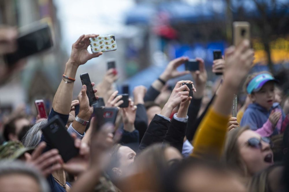 Cellphones in the crowd try to capture the elite women's final. (Jesse Costa/WBUR)