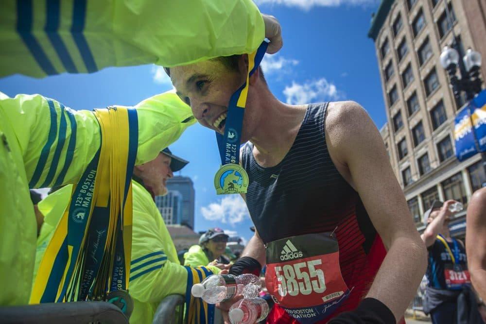 A happy Pete Sullivan receives his Boston Marathon medal. (Jesse Costa/WBUR)