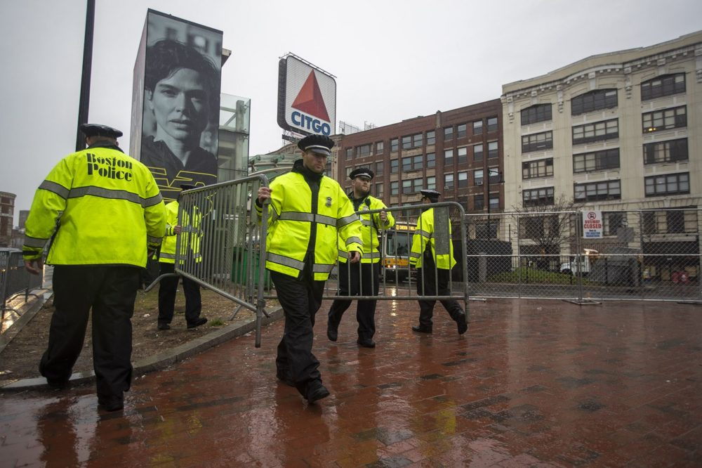 Boston Police set up barriers along Commonwealth Ave in Kenmore Square before the Boston Marathon begins. (Jesse Costa/WBUR)