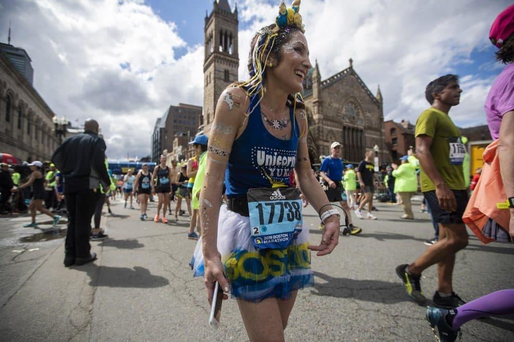 Yuki Chorney dressed up as a unicorn, the Boston Marathon mascot. (Jesse Costa/WBUR)