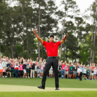 Tiger Woods celebrates after making his putt on the 18th green to win the Masters at Augusta National Golf Club on April 14, 2019, in Augusta, Ga. (Kevin C. Cox/Getty Images)